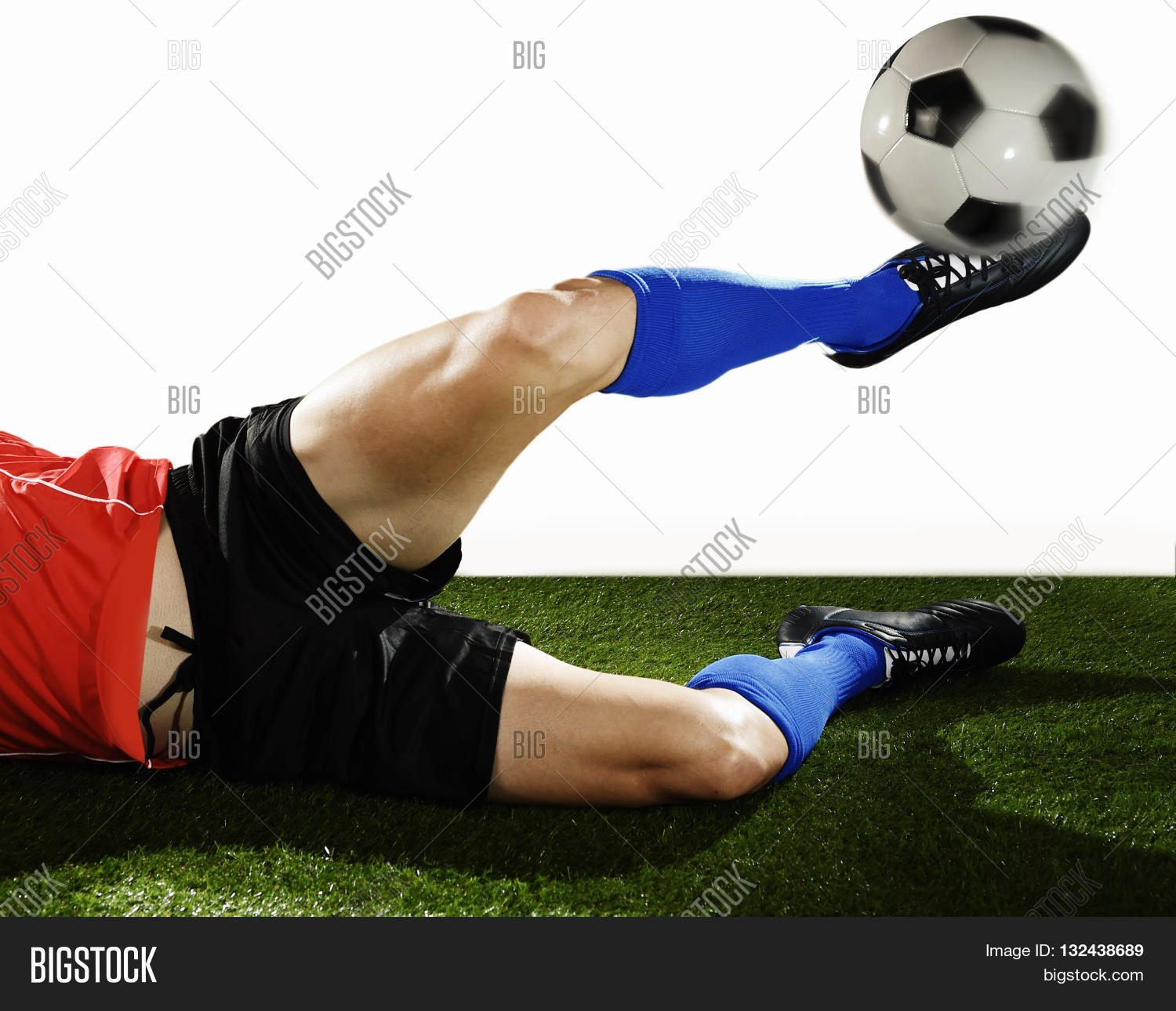 fd9830fdd football player in action doing tackle and kicking ball isolated on white  background wearing red jersey