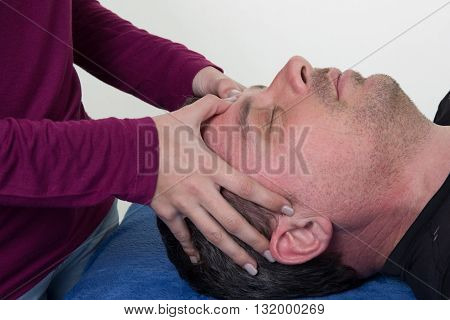 Woman Doing A Face And Head Massage At Health Center