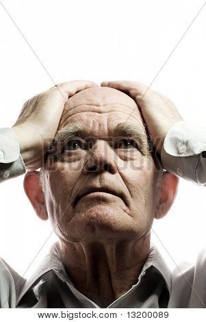 Elderly man in despair. Isolated on white background