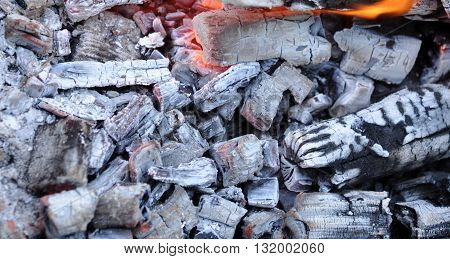 BBQ Grill Pit With Glowing And Flaming Hot Coals Food Background Or Texture Close-Up Top View