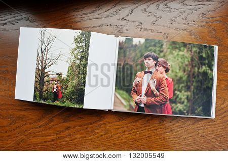 Open Pages Of Album Photobook Couple In Love On Wooden Background