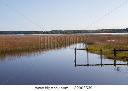 Clean the landscape North of the river with the old docks. Wildlife of the North. Idyllic picture. The peace and tranquility of nature.