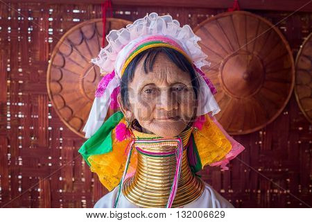INLE LAKE MYANMAR - JANUARY 14 2016: Padaung Tribal woman poses for a photo in Inle lake Burma The Padaung-Karen long-necked tribe women are minority of Myanmar.