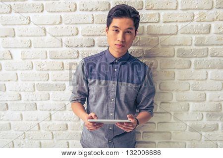 Handsome Asian Guy With Gadget