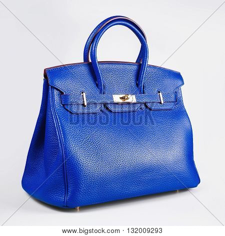 female blue handbag on a white background