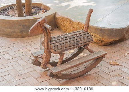 Cute vintage classic rocking horse chair children could enjoy the riding, Thailand style.