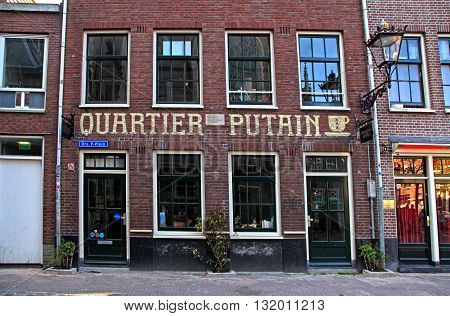 AMSTERDAM, NETHERLANDS - MAY 5, 2016: Quartier Putain cafe in Amsterdam's red lights district near Oude Kerk(Old Church) in Amsterdam Netherlands.