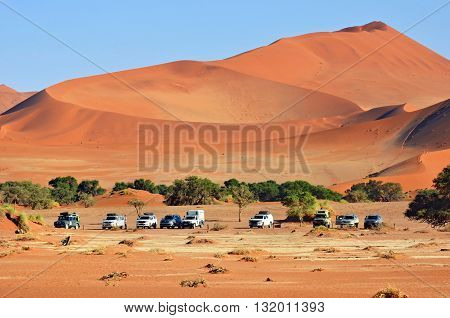 SOSSUSVLEI NAMIBIA - JAN 29 2016: Tourists visit the Namib-Naukluft National Park. The most visited place in Namibia