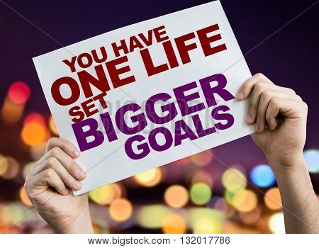You Have One Life Set Bigger Goals placard with bokeh background