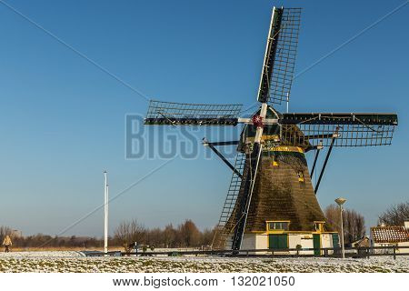 Windmill with view in Holland in the winter