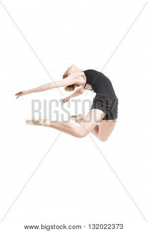 Unrecognizable blonde ballet dancer in ballet shoes jumping