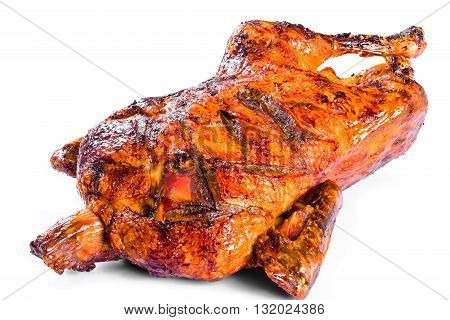 Roasted Whole Duck in honey mustard soy glaze on a white background close-up