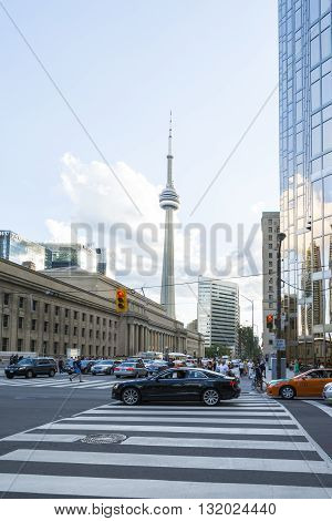 TORONTO,CANADA-AUGUST 2, 2015: view of the CNN towers in Toronto during a sunny day from one of the central streets of the city.