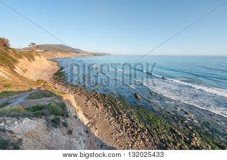 A cliff view of the Pacific ocean at low tide in Carpinteria California.