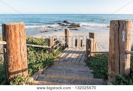 Stairs leading down to the beach and Pacific ocean at Carpinteria State Beach California.
