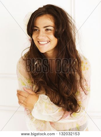 portrait of pretty young brunette woman in white room dancing, smiling cheerful, lifestyle people concept close up