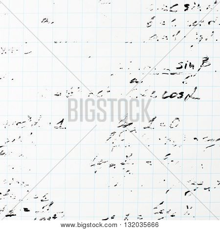 Squared sheet of paper filled with partially erased trigonometry math equations and formulas as a background composition