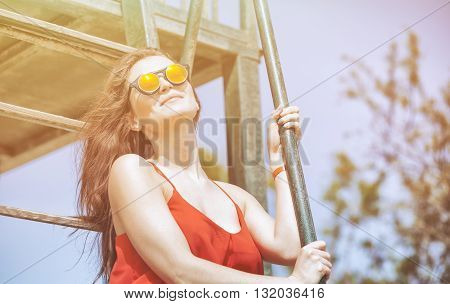 Young Woman On The Beach In Hot Summer Sun Light