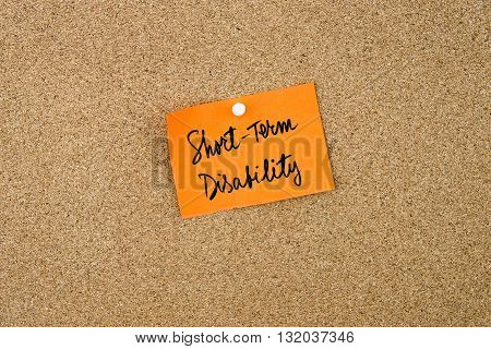 Short Term Disability Written On Orange Paper Note