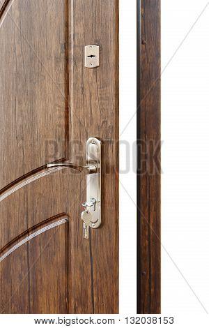 Open door handle. Door lock with keys. Brown wooden door closeup isolated. Modern interior design, door handle. New house concept. Real estate. Vertical image