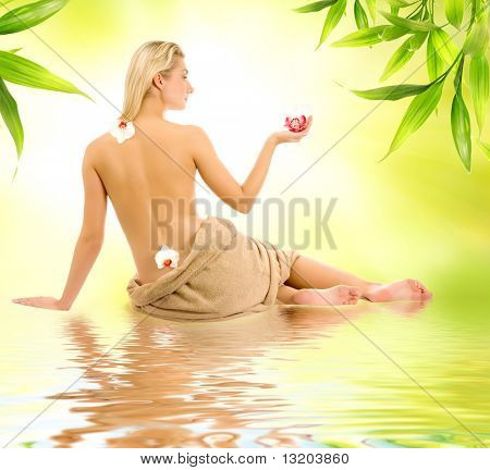 Beautiful young woman ready for spa treatment