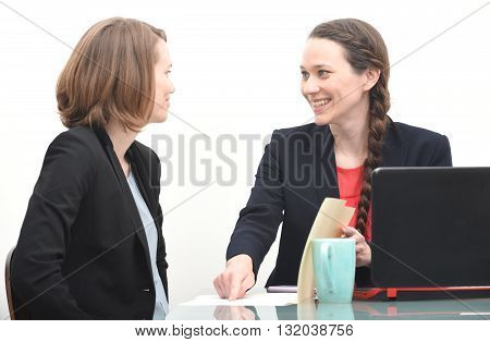 Happy business woman getting instructions from her boss