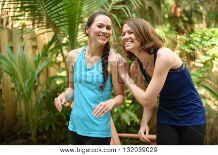 Two women or sisters sharing a funny moment in friendship