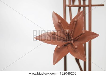 Forged metal products. Flowers and leaves are forged and coated with a primer. design elements. On a white background.
