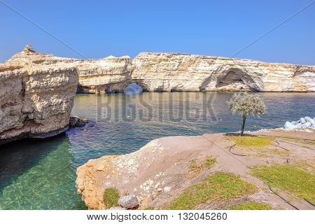 Natural hole in rock formation out in the sea