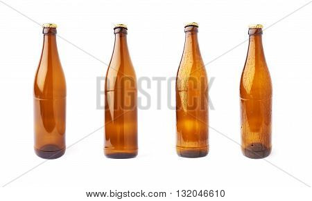 Empty brown beer glass bottle isolated over white background