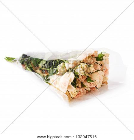 Bouquet of white roses in plastic covering over white isolated background