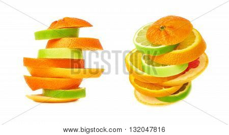 Stack of mixed citrus sliced fruits over white isolated background