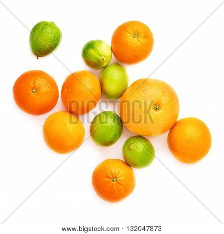 Surface covered with different citrus fruits over white isolated background
