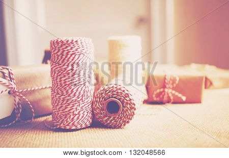 Spools Of Yarn On A Desk With  Gift Boxes