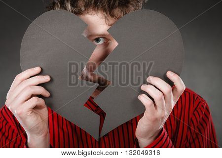 Man Covering Behind Cutout Heart