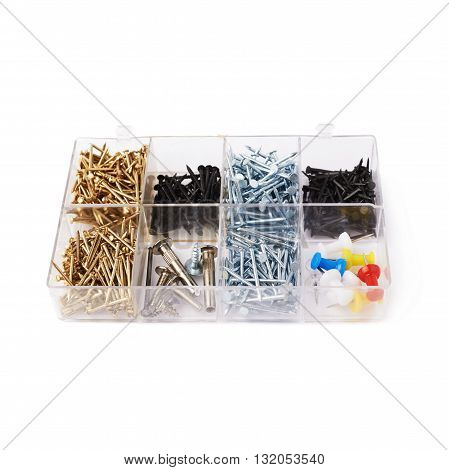 Collection of nails in plastic box isolated over white background