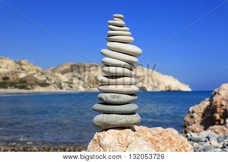 Stones pyramid on sea shore an sunny day