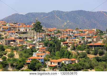 Red house roofs of Mediterranean village in Cyprus mountains