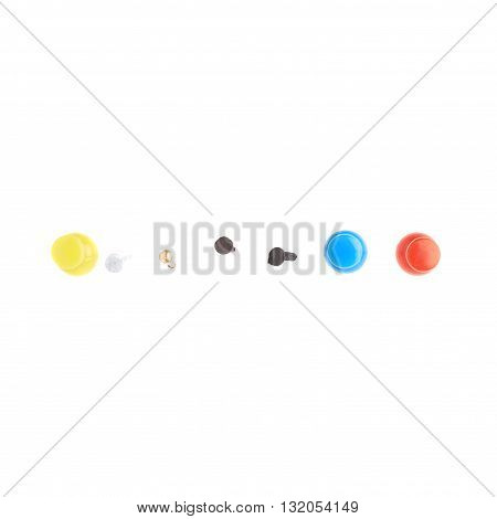 Collection of plastic pins and metal nails over white isolated background