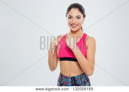 Happy sports woman posing isolated on a white background