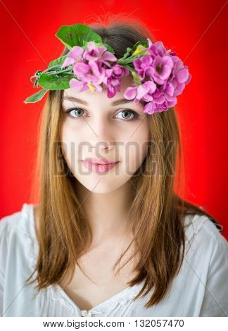 Beauty girl takes beautiful flowers on her hair