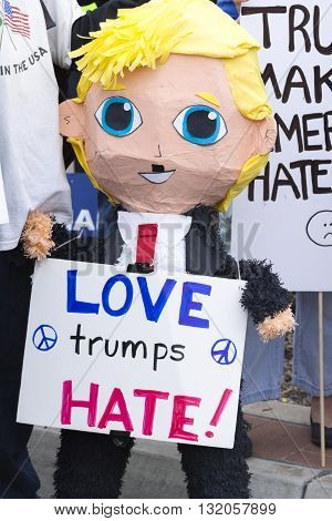 SAN DIEGO USA - MAY 27 2016: A Mexican pinata in the form of a smiling Donald Trump holds a sign reading