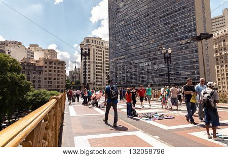 SAO PAULO, BRAZIL - CIRCA JAN 2015: People walking at Efigenia bridge in Sao Paulo, Brazil.