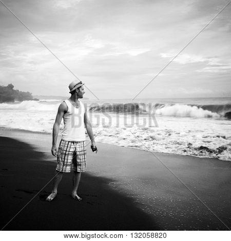Man watching power of the ocean.