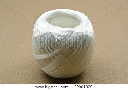 White Plastic Rope On Brown Background.