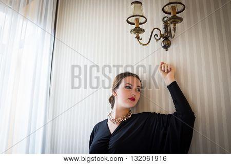 Beautiful girl posing on vintage wall