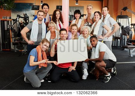 Group of people holding a white sign as advertising tool at the gym