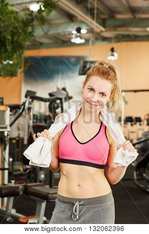 Woman after workout at fitness studio
