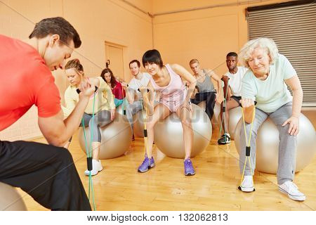 Group with active senior training with expanding band