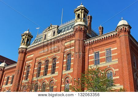 Beautiful historic building designed by Smithsonian architect Adolf Cluss in 1869. National Landmark - Franklin School building in Washington DC USA.
